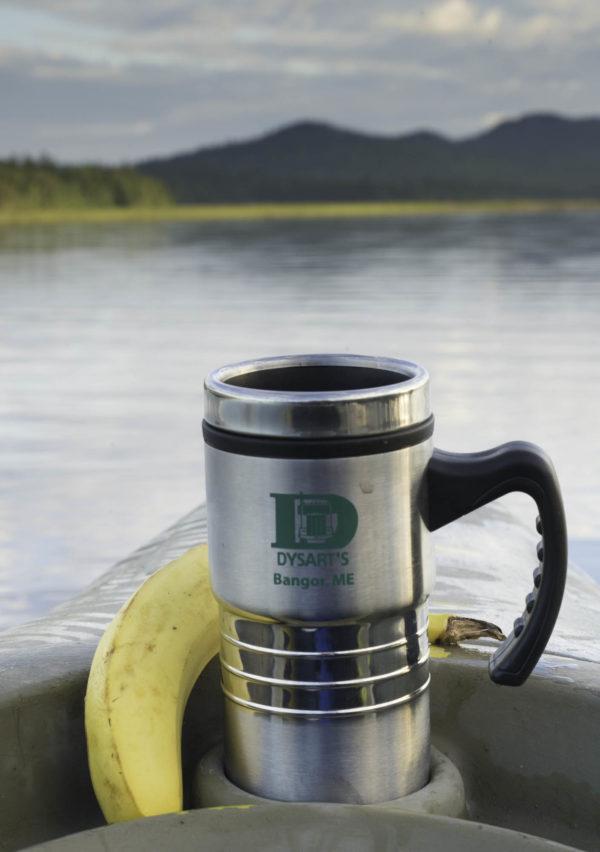 photo of dysart's travel mug in boat on lake