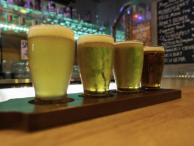 photo of four glasses of beer on dysart's bar