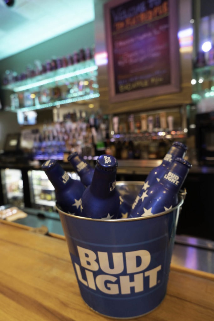 photo of bud light bucket filled with beers on dysart's bar