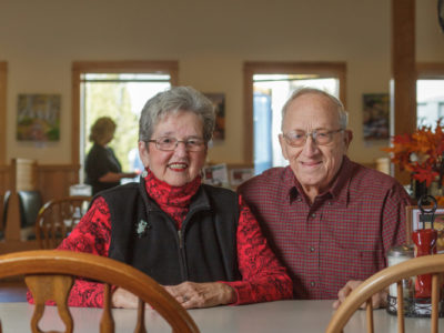 photo of elderly man and woman sitting at a Dysart's table