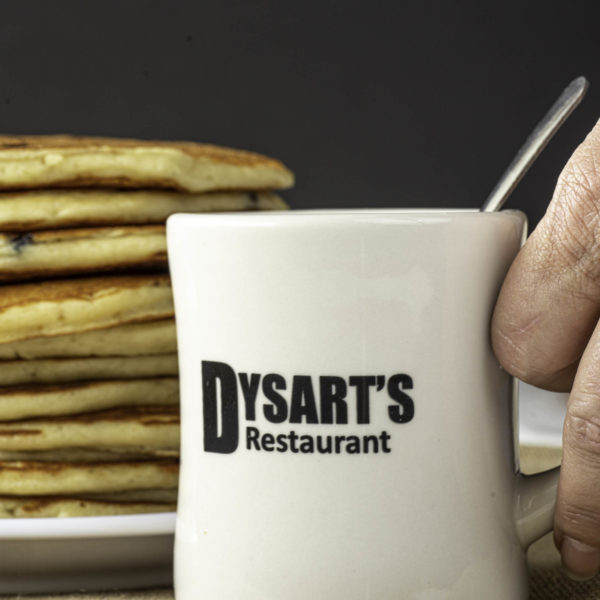 photo of dysart's restaurant coffee mug in front of stack of pancakes