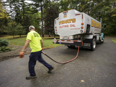 photo of man delivering Home Heating Oil